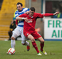 Raith's David Smith and Morton's David Graham challenge for the ball.
