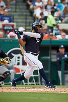Detroit Tigers third baseman Jeimer Candelario (46) follows through on a swing during a Grapefruit League Spring Training game against the New York Yankees on February 27, 2019 at Publix Field at Joker Marchant Stadium in Lakeland, Florida.  Yankees defeated the Tigers 10-4 as the game was called after the sixth inning due to rain.  (Mike Janes/Four Seam Images)
