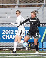 Wilmington University forward Brittany Rhodes (4) attempts to control the ball as College of St Rose forward Molly Harpster (9) defends.. In 2012 NCAA Division II Women's Soccer Championship Tournament First Round, College of St Rose (white) defeated Wilmington University (black), 3-0, on Ronald J. Abdow Field at American International College on November 9, 2012.