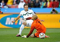 Zlatan Ljubijankic of Slovenia scores the second goal past USA goalkeeper Tim Howard, 2-0