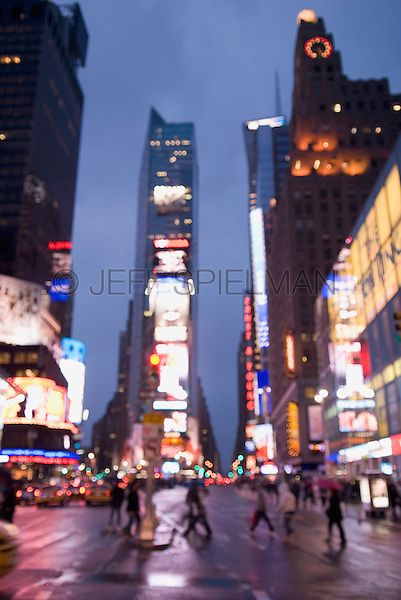 AVAILABLE FROM JEFF AS A FINE ART PRINT.<br /> <br /> A SIMILAR TO THIS IMAGE IS AVAILABLE FROM PLAINPICTURE FOR COMMERCIAL AND EDITORIAL LICENSING.  Please go to www.plainpicture.com and search for image # p5690099.<br /> <br /> Soft Focus/Defocussed view of Times Square at Dusk, with pedestrians crossing the street in the foreground....Midtown Manhattan, New York City, New York State, USA