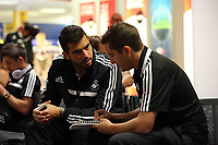 Wednesday 28 August 2013<br /> Pictured L-R: Jordi Amat interviewed by Chris Barney at Cardiff Airport.<br /> Re: Swansea City FC players and staff en route for their UEFA Europa League, play off round, 2nd leg, against Petrolul Ploiesti in Romania.