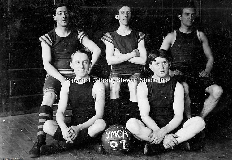 Pittsburgh PA:  View of Brady Stewart (top right) and other members of the McKeesport YMCA Basketball team.