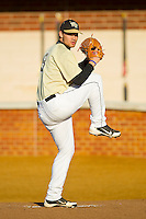 Wake Forest Demon Deacons starting pitcher Austin Stadler (9) warms up in the bullpen prior to the game against the North Carolina State Wolfpack at Wake Forest Baseball Park on March 15, 2013 in Winston-Salem, North Carolina.  The Wolfpack defeated the Demon Deacons 12-6.  (Brian Westerholt/Four Seam Images)