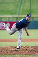 AZL Brewers starting pitcher Chase Williams (59) follows through on a warmup pitch during a game against the AZL Cubs on August 1, 2017 at Sloan Park in Mesa, Arizona. Brewers defeated the Cubs 5-4. (Zachary Lucy/Four Seam Images)