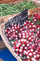 Street market merchant's stall with red and white radishes Sanary Var Cote d'Azur France