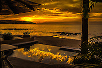 Fine Art Landscape Photograph. Sunset on Banderas Bay, Puerto, Vallarta, Mexico. The golden rays of the setting sun reflecting clouds onto a infinity pool.