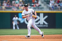 Charlotte Knights third baseman Matt Davidson (22) tracks a ground ball during the game against the Norfolk Tides at BB&T BallPark on June 7, 2015 in Charlotte, North Carolina.  The Tides defeated the Knights 4-1.  (Brian Westerholt/Four Seam Images)