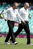 7th January 2021; Sydney Cricket Ground, Sydney, New South Wales, Australia; International Test Cricket, Third Test Day One, Australia versus India; umpires Paul Reiffel and  Paul Wilson inspect the pitch after a rain delay