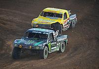 Dec. 11, 2011; Chandler, AZ, USA;  LOORRS pro 2 driver Jeremy McGrath leads Rob Naughton during the Lucas Oil Challenge Cup at Firebird International Raceway. Mandatory Credit: Mark J. Rebilas-