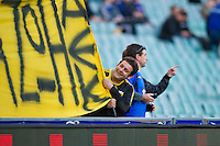 SYDNEY, AUSTRALIA - JULY 31, 2010: AEK Athens fan preparing his banner prior to the match between AEK Athens FC and Glasgow Rangers during the 2010 Sydney Festival of Football held at the Sydney Football Stadium on July 31, 2010 in Sydney, Australia. (Photo by Sydney Low / www.syd-low.com)