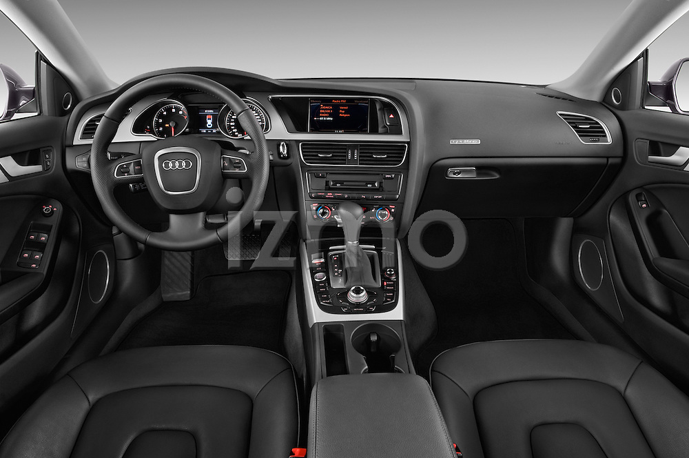 Straight dashboard view of a 2009 - 2011 Audi A5 Ambition Luxe Sportback 5-Door Hatchback.