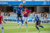 SAN JOSE, CA - APRIL 24: Cade Cowell #44 of the San Jose Earthquakes heads the ball past Matt Hedges #24 of FC Dallas during a game between FC Dallas and San Jose Earthquakes at PayPal Park on April 24, 2021 in San Jose, California.