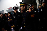 Police hold back travelers trying to enter the train station in Nanchang, China, during the heavy traveling period before the Spring Festival.  The country's train system was severely crippled by some of the worst winter weather in China in more than 50 years, and many travelers were forced to abandon travel plans or wait out the weather while stranded in train stations far from home.