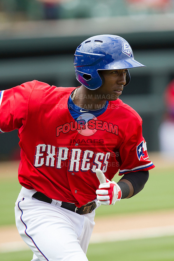 Round Rock Express second baseman Jurickson Profar #10 hustles down the first base line against the Omaha Storm Chasers in the Pacific Coast League baseball game on April 7, 2013 at the Dell Diamond in Round Rock, Texas. Omaha beat Round Rock 5-2, handing the Express their first loss of the season. (Andrew Woolley/Four Seam Images).