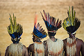 Four Xerente warrior participants watch the opening ceremony at the first ever International Indigenous Games, in the city of Palmas, Tocantins State, Brazil. Photo © Sue Cunningham, pictures@scphotographic.com 23rd October 2015
