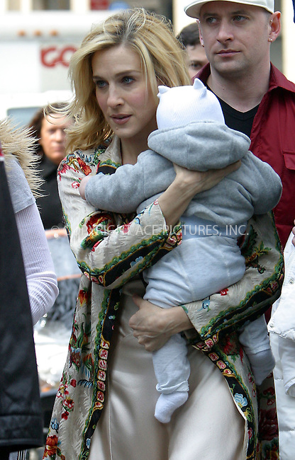 """Actress Sarah Jessica Parker tried to combine her parental and acting duties as she brought her baby to the set of HBO's popular series """"Sex and the City."""" Sarah was seen walking around with her bundle of joy under heavy guard of her bodyguards and police officers. New York, April 2, 2003. Please byline: Alecsey Boldeskul/NY Photo Press.   ..*PAY-PER-USE*      ....NY Photo Press:  ..phone (646) 267-6913;   ..e-mail: info@nyphotopress.com"""
