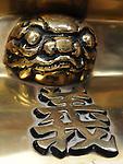 Bao-jhong Yi-min Temple, Kaohsiung -- Ornament detail on a brass joss stick brazier.