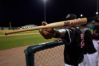 Batavia Muckdogs Brayan Hernandez (23) holds up a souvenir mini bat during a NY-Penn League game against the West Virginia Black Bears on June 25, 2019 at Dwyer Stadium in Batavia, New York.  Batavia defeated West Virginia 7-3.  (Mike Janes/Four Seam Images)