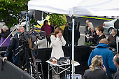 A Sky News presenter prepares to interview newly elected Green MP Caroline Lucas on College Green, Westminster, as politicians from the three main parties negotiate following an indecisive result in the 2010 General Election.