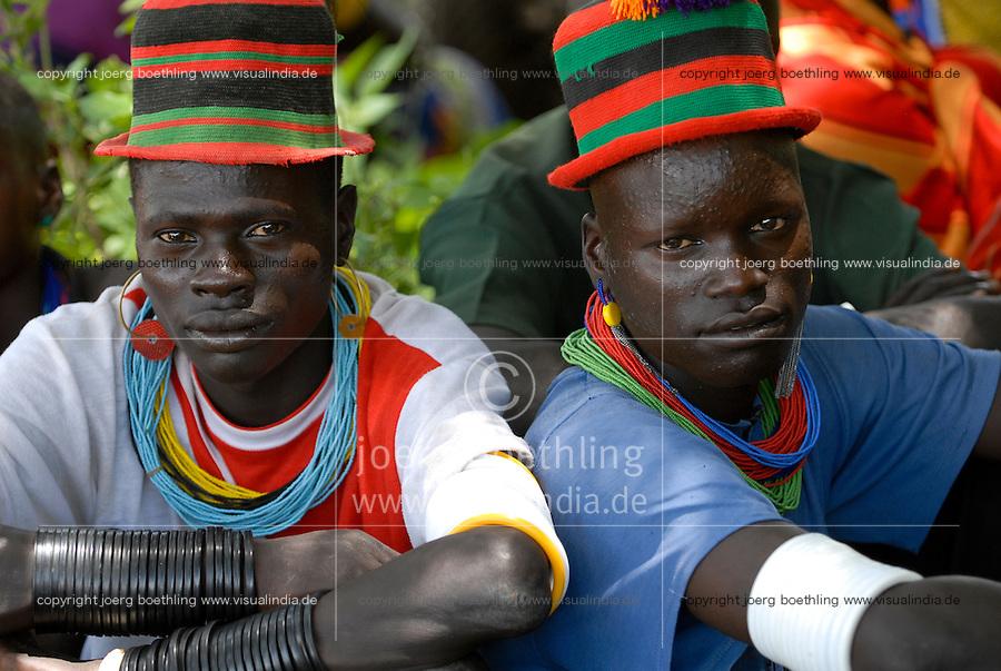 UGANDA Karamoja, Kotido, Karimojong pastoral tribe, two warrior with necklace and colourful hat / UGANDA Karamoja, Kotido, Karimojong, Zwei Krieger mit bunten Hueten und Halskette