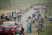 the breakaway group over the cobbles of the Pont-à-Celles sector (1800m) <br /> <br /> stage 4: Seraing (BEL) - Cambrai (FR) <br /> 2015 Tour de France