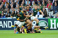 07 October 2015: Andrew Suniula of USA drives forward as Tendai Mtawarira of South Africa tries to relieve him of the ball during Match 31 of the Rugby World Cup 2015 between South Africa and USA - Queen Elizabeth Olympic Park, London, England (Photo by Rob Munro/CSM)
