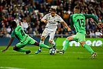 Luka Modric of Real Madrid and Kenneth Josiah Omeruo (L) and Rodrigo Tarin (R) of CD Leganes during La Liga match between Real Madrid and CD Leganes at Santiago Bernabeu Stadium in Madrid, Spain. October 30, 2019. (ALTERPHOTOS/A. Perez Meca)