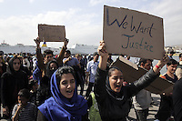 Pictured: Protesters with placards gather in Piraeus port Tuesday 08 March 2016<br /> Re: Afghan migrants hold a protest at Piraeus port, near Athens, Greece.