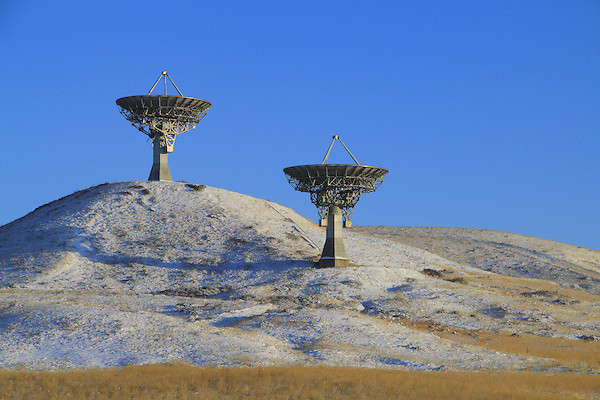 Two satellite dishes, radio telescopes, pointed towards the heavens, Front Range, Colorado, USA .  John leads private photo tours in Boulder and throughout Colorado. Year-round Colorado photo tours.