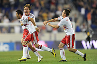 Juan Pablo Angel (9) of the New York Red Bulls celebrates scoring the game winning goal with Chris Albright (3) and Seth Stammler (6). The New York Red Bulls defeated the Houston Dynamo 2-1 during a Major League Soccer (MLS) match at Red Bull Arena in Harrison, NJ, on June 2, 2010.