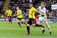 (L-R) Richarlison of Watford challenged by Sam Clucas of Swansea City during the Premier League match between Watford and Swansea City at the Vicarage Road, Watford, England, UK. Saturday 30 December 2017