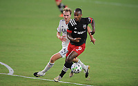 WASHINGTON, DC - AUGUST 25: Ola Kamara #9 of D.C. United battles for the ball with Henry Kessler #4 of New England Revolution during a game between New England Revolution and D.C. United at Audi Field on August 25, 2020 in Washington, DC.