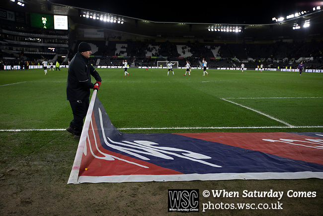 A groundsman rolling up a sponsor's banner after Derby County played Stoke City in an EFL Championship match at Pride Park Stadium. Opened in 1997, it is the 16th-largest football ground in England and the 20th-largest stadium in the United Kingdom. The fixture ended in a 0-0 draw watched by a crowd of 25,685.