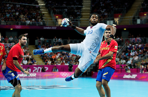 08 AUG 2012 - LONDON, GBR - Cedric Sorhaindo (FRA) of France (centre) shoots during the men's London 2012 Olympic Games quarter final match against Spain at the Basketball Arena in the Olympic Park, in Stratford, London, Great Britain (PHOTO (C) 2012 NIGEL FARROW)