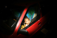 CHINA. Beijing. A young boy looks out of a car window in the shopping district of Xinjiekou . 2008
