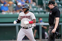 Ezequiel Duran (17) of the Hickory Crawdads gestures as he crosses the plate with a home run in a game against the Greenville Drive on Friday, August 27, 2021, at Fluor Field at the West End in Greenville, South Carolina. The umpire is Mitch Leikam. (Tom Priddy/Four Seam Images)