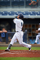 Charlotte Stone Crabs catcher Brett Sullivan (8) follows through on a swing during the first game of a doubleheader against the Tampa Yankees on July 18, 2017 at Charlotte Sports Park in Port Charlotte, Florida.  Charlotte defeated Tampa 7-0 in a game that was originally started on June 29th but called to inclement weather.  (Mike Janes/Four Seam Images)