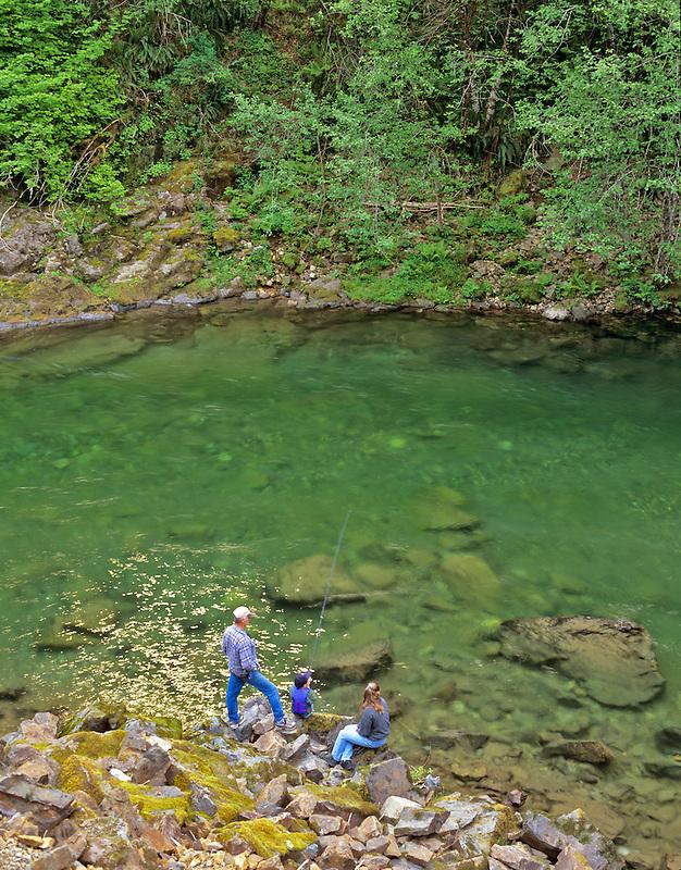 Family fishing on Quartzville Creek. Quartzville Creek Wild and Scenic River, Oregon