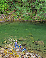 Family fishing on Quartzville Creek. Quartzville Creek Wild and Scenic River, Oregon