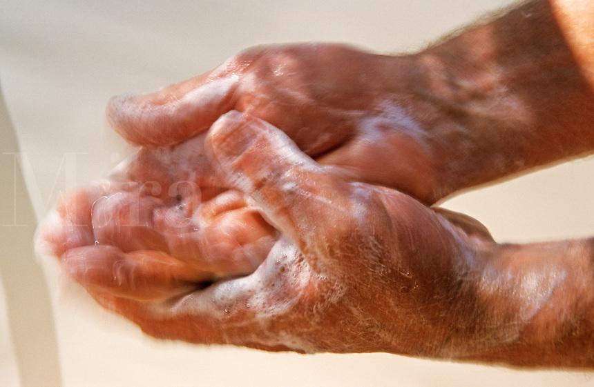 Man washing hands.  Movement blur