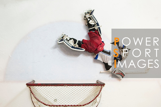 Gaggia Empire Goalkeeper #1 Rex Kong is on the floor during the match Gaggia Empire vs Verity, a match part of the Principal Standard League on 07 March 2017 in Mega Ice, Hong Kong, China. Photo by Marcio Rodrigo Machado / Power Sport Images