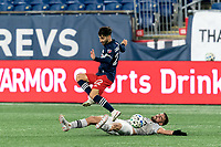 FOXBOROUGH, MA - NOVEMBER 20: Rudy Camacho #4 of Montreal Impact tackles Carles Gil #22 of New England Revolution during the Audi 2020 MLS Cup Playoffs, Eastern Conference Play-In Round game between Montreal Impact and New England Revolution at Gillette Stadium on November 20, 2020 in Foxborough, Massachusetts.