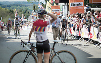 world champion/legend Marianne Vos (NLD/Rabobank-Liv) crossing the finish line sheering as if she won the race herself, but simply super happy for her teammate Pauline Ferrand Prevot (FRA/Rabobank-Liv), who awaits Vos behind the line<br /> <br /> <br /> La Flèche Wallonne 2014