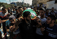 relatives of Saher Othman, 20, mourn during his funeral in Rafah in the southern Gaza Strip<br /> September 28, 2019. A Palestinian was killed by Israeli fire during a demonstration calling for the lifting of years of siege on the Gaza Strip along the Gaza-Israel border fence on Friday. <br /> <br /> PHOTO : Agence Quebec Presse  - YOUSEF MASOUD