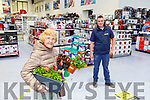 Teresa Cahillane getting some flowers in MD O'Shea's Hardware store on Monday with Anthony Doona on hand to help out
