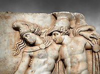 Close up of a Roman Sebasteion relief sculpture of Achilles and a dying Amazon, Aphrodisias Museum, Aphrodisias, Turkey.    Against a grey background.<br /> <br /> Achilles supports the dying Amazon queen Penthesilea whom he has mortally wounded. Her double headed axe slips from her hands. The queen had come to fight against the Greeks in the Trojan war and Achilles fell in love with her.