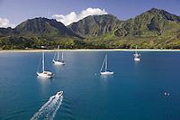 Cruising sailboats in beautiful Hanalei Bay