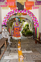 Oaxaca; Mexico; North America; Day of the Dead Celebrations.  Skeletons Welcome Guests in the Entryway to the Courtyard of a Small Boutique Hotel, La Casa de las Bugambillas.