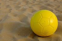 A football in the sand on Ipanema beach in Rio de Janeiro